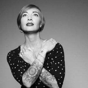 Laura Hobbs shows off her tattoos