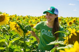 Kristy Lewis stands in a field of sunflowers.