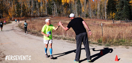 Jeff Stoner high-fives a race participant