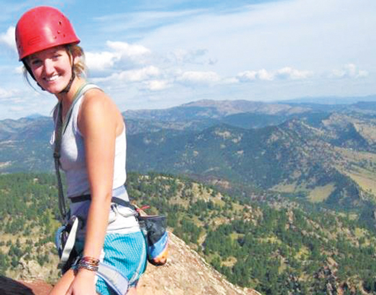 Jessi Hackett dons climbing gear. Photo by: Allison France