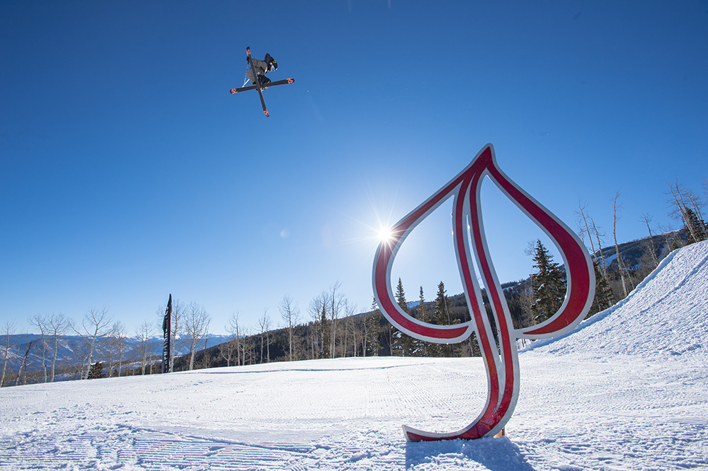 Tristan Feinberg jumping off big kickers in the terrain park while skiing in the mountains at Aspen Snowmass Ski Resort in Colorado